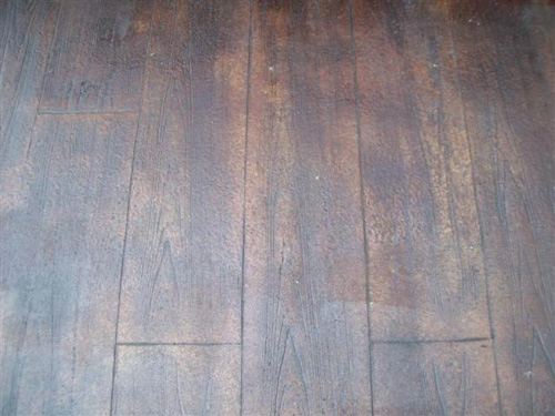 Concrete that 39 s been stamped and stained to look like for Hardwood floor concrete stamp